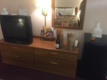 Dresser, mini fridge, television