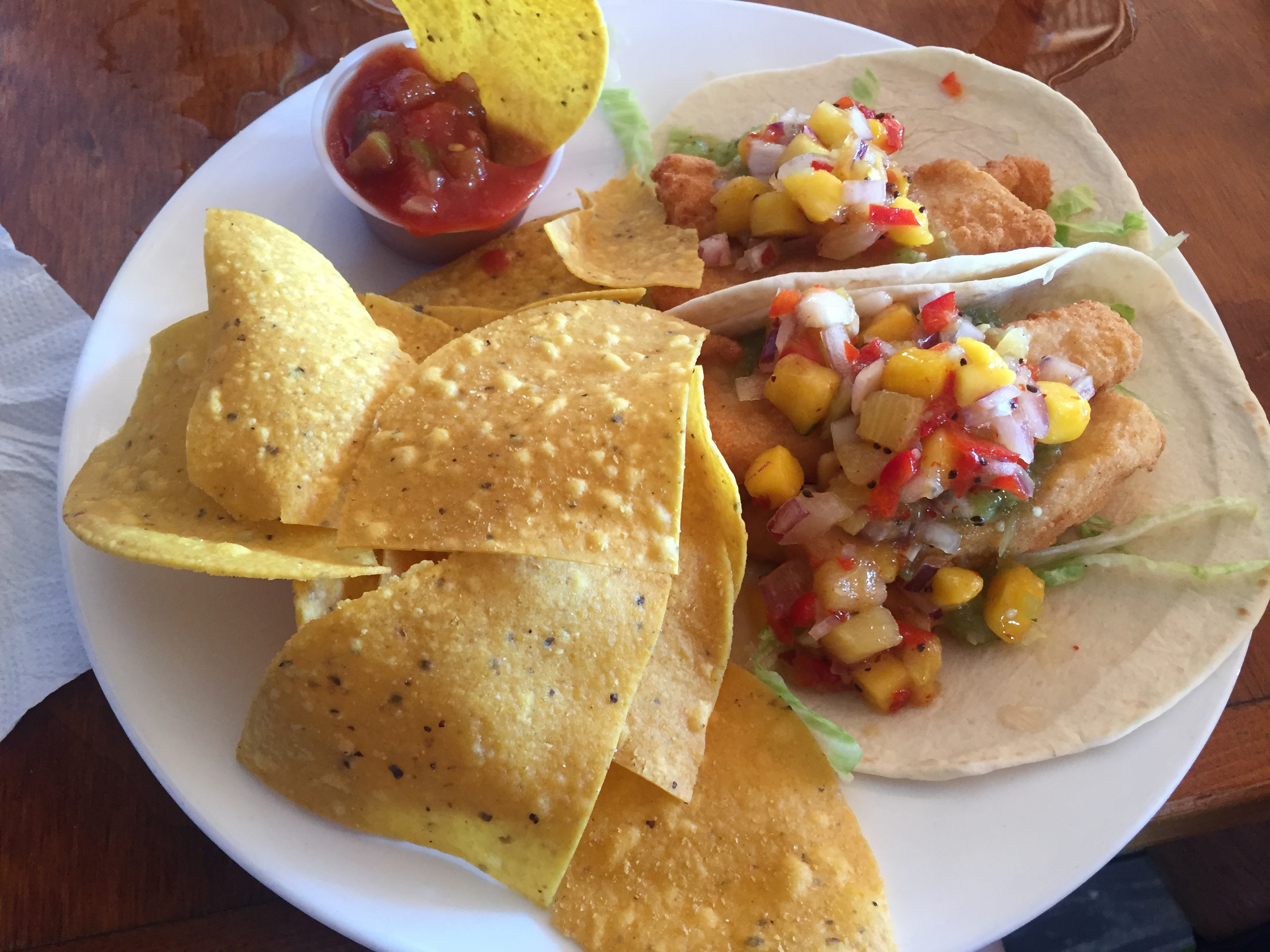 Fish tacos with mango salsa verde and chips from Gilligan's Island Grill in Sarasota.